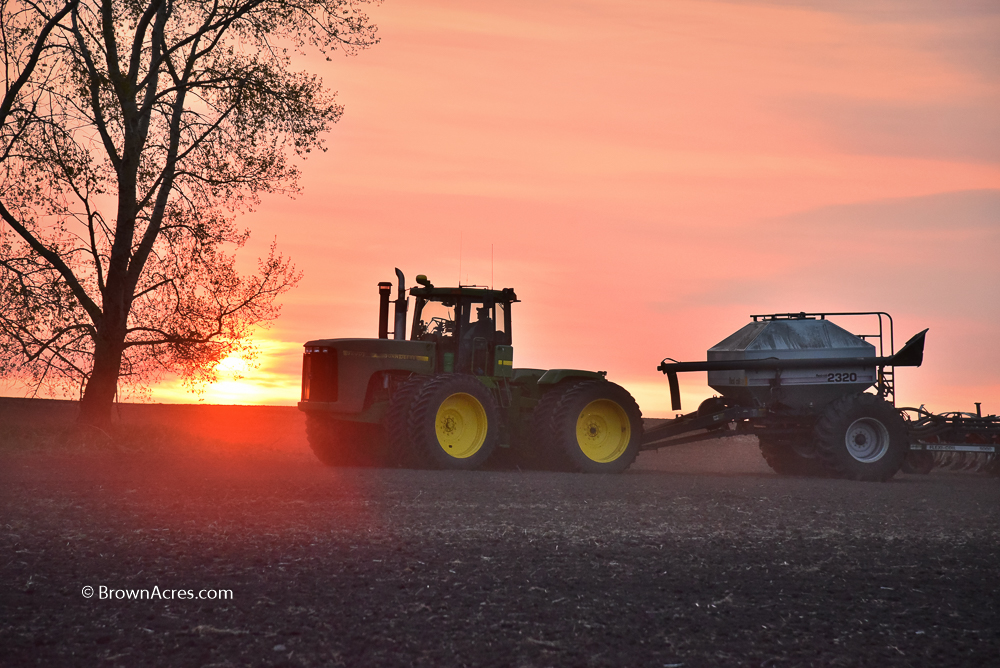 Farmer Sunset John Deere 9200 with Bourgault drill planting Canola